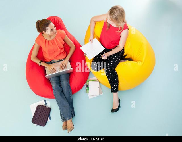 Businesswomen Working In Bean Bag Chairs