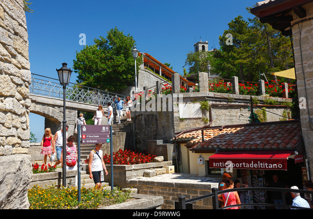 Tourists walking past shop stock photos tourists walking for Flights to san marino italy