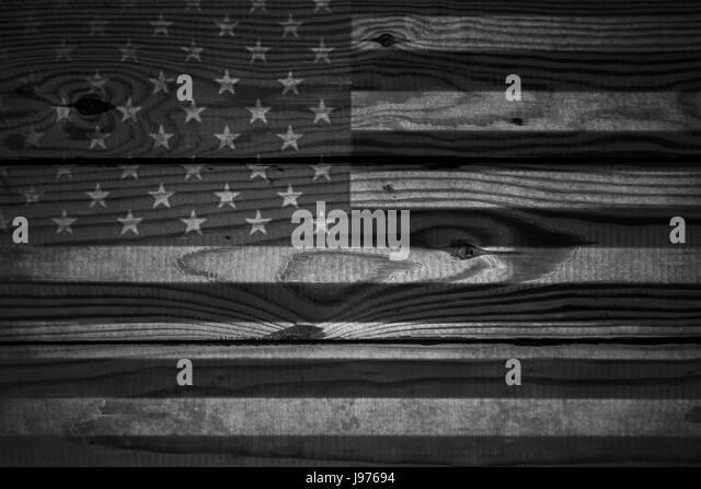 Vintage American Flag Painted On Aged Weathered Rustic Wooden Background