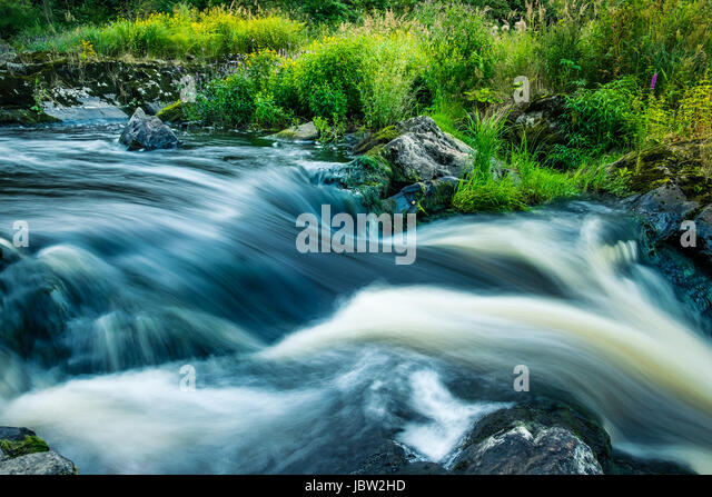 Landscape with flowing river and nice light at summer time - Stock Image