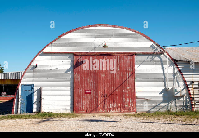 Corrugated Metal Barn With Red Door.   Stock Image