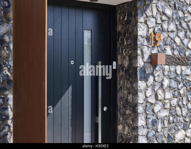 Black Door With Flint And Rusted Corten Steel. House 19