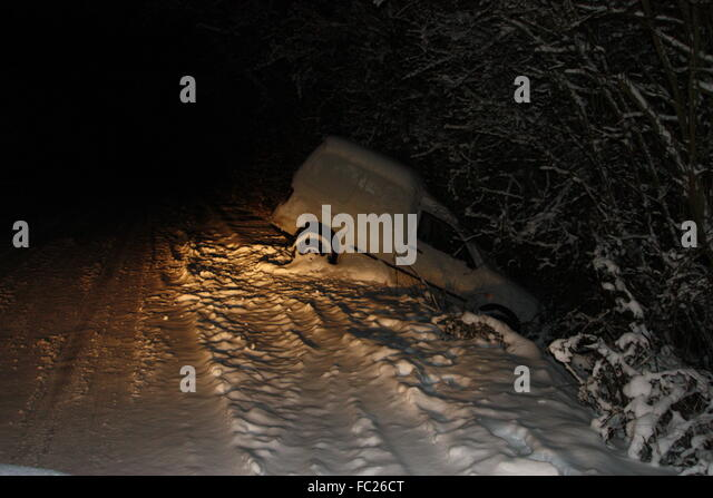 A Van Skidded Into A Ditch On A Snowy Night Caught In The Headlights Fc Ct