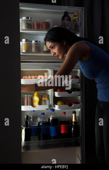 Dark Kitchen At Night dark kitchen woman night stock photos & dark kitchen woman night