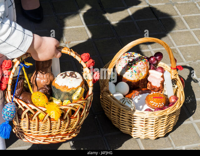 Russian easter eggs stock photos russian easter eggs stock images a little girl holding a cane basket filled with easter offerings of eggs and cakes to negle Images