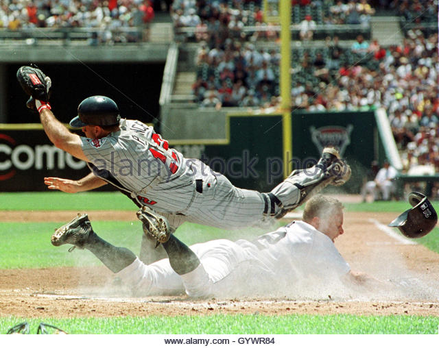 detroit tigers catcher brandon inge slides safe into home plate as minnesota twins catcher: american colonial homes brandon inge
