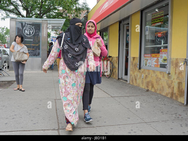2 Islamic women (presumably mother & daughter) walking on 37th Ave in Jackdon Heights Queens, New York City - Stock Image