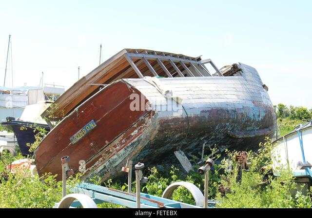 Old Wooden Boat Lying On Side - Stock Image
