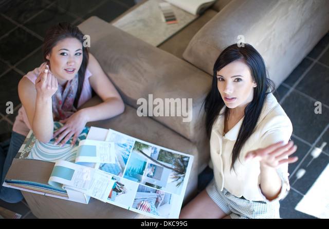 Interior Designer And Client With Scrap Book