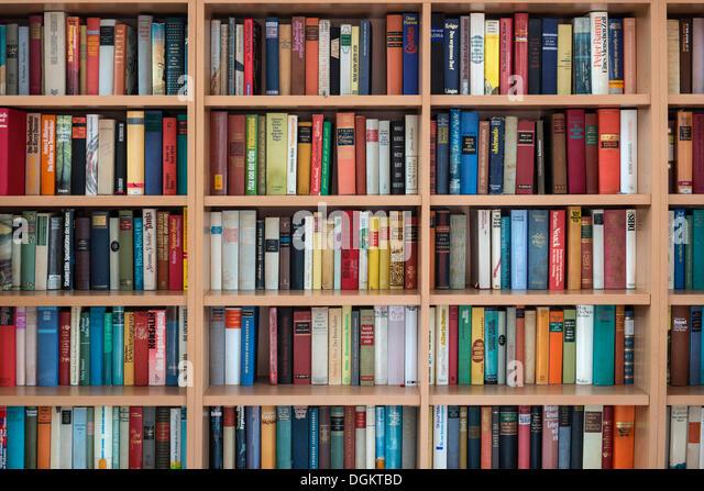 Full bookshelves, German books - Stock Image