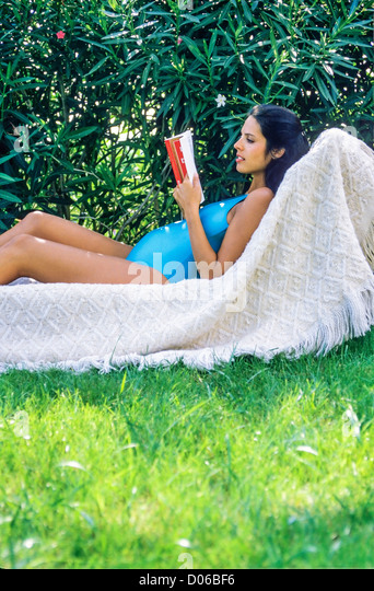 Pregnant woman relaxing model released stock photos for Gardening while pregnant