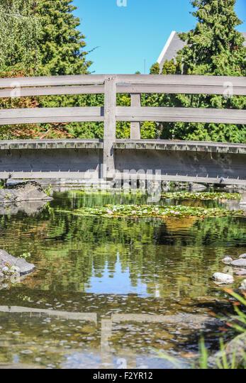Bridge over pond stock photos bridge over pond stock for Koi fish pond kelowna