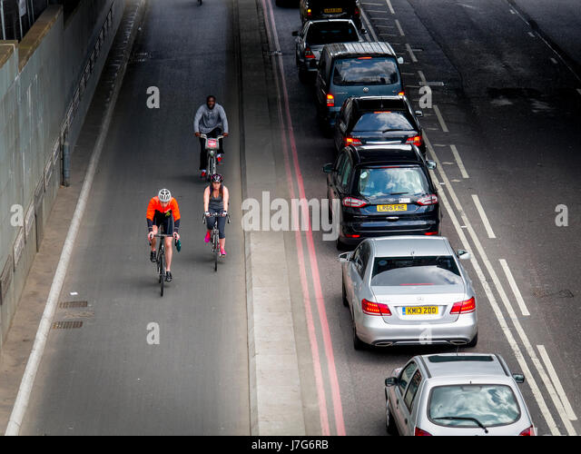Cyclists using the TFL Cycle Superhighway in Upper Thames Street, London. Opened in 2016. - Stock Image
