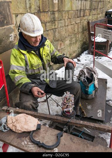 telecoms technician stock photos telecoms technician stock bt technician at work wiring telephone connections durham england uk stock image
