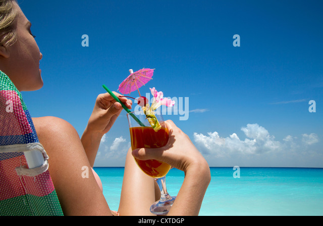 Woman With Tropical Drink On Beach
