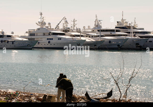 piraeus women In piraeus, men and women of the greek coast guard oversee the situation in the morning  refugee conditions in greece are about to get much, much worse.
