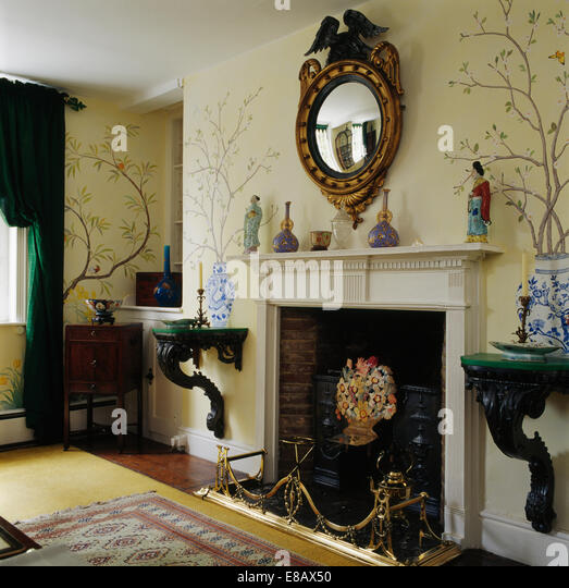 Antique Gesso Gikrandole Mirror Above Fireplace In Country Dining Room With Rococo Wall Shelves