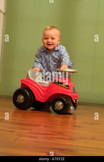 Little Boy With Toy Car : Toddler riding toy car stock photos