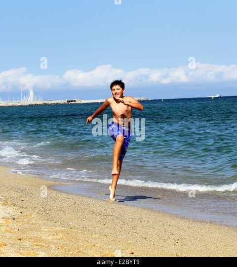 Boy Running On The Sea Beach Summer Holidays