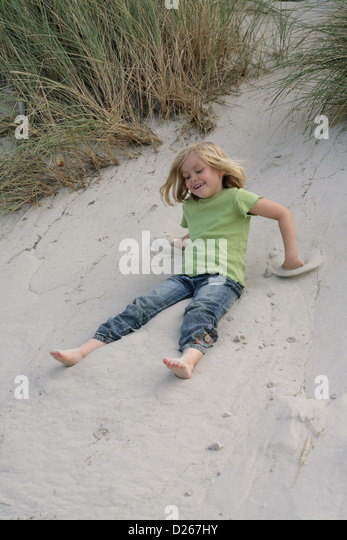 http://l7.alamy.com/zooms/9e207b38ce5b47fca565e31d9f43cae8/amrum-wittduen-germany-5-year-old-girl-playing-in-the-dunes-d267hy.jpg