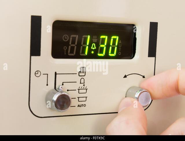 setting alarm clock stock photos setting alarm clock stock images alamy. Black Bedroom Furniture Sets. Home Design Ideas