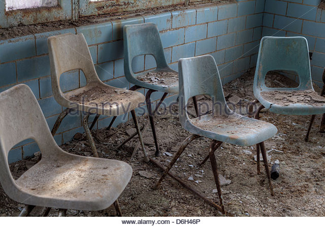 Old Broken Chairs In Abandoned Stock Photos