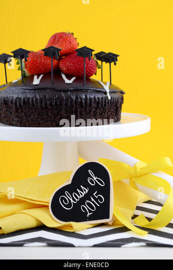 happy graduation day yellow black and white theme party with chocolate cake and