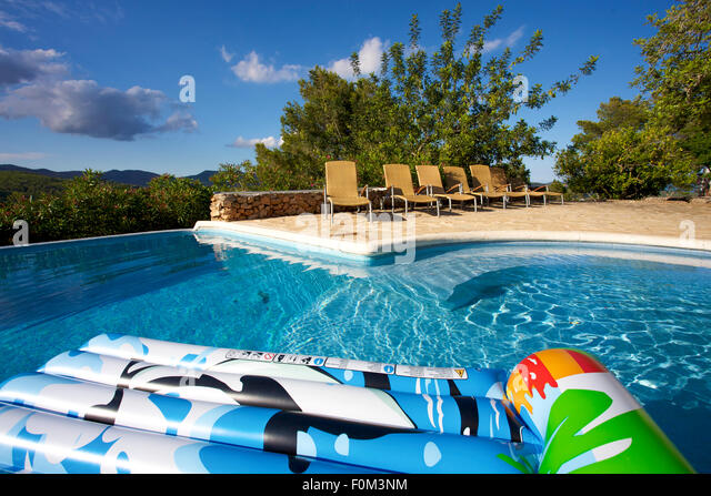 Floating air bed mattress stock photos floating air bed for Swimming pool bed