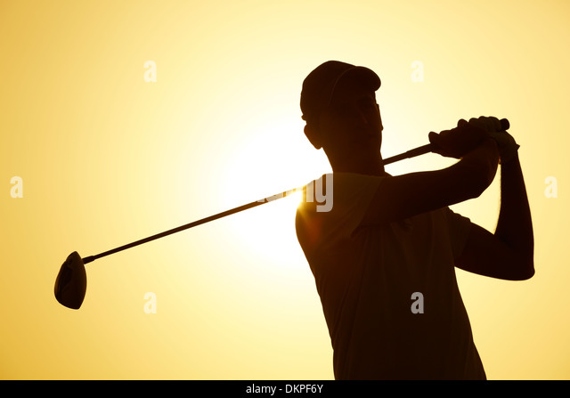 silhouette of man playing golf outdoors stock image