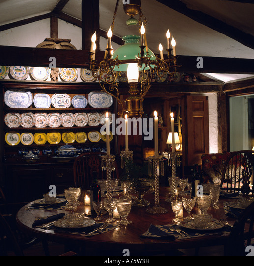 Cottage Diningroom With Dresser And Victorian Lantern Chandelier Above Table Set For Dinner