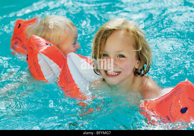 Swimming Pool Wings : Little boy water wings stock photos