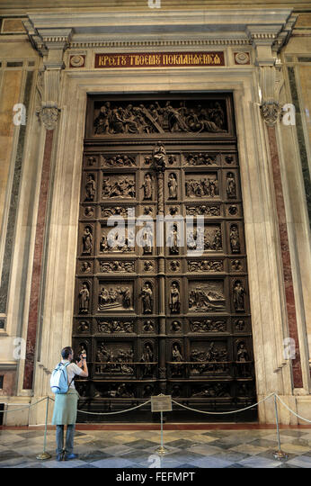 A tourist photographs the bronze doors covered in reliefs by Ivan Vitali inside St & Bronze Doors Saint Isaacs Cathedral Stock Photos \u0026 Bronze Doors ... Pezcame.Com
