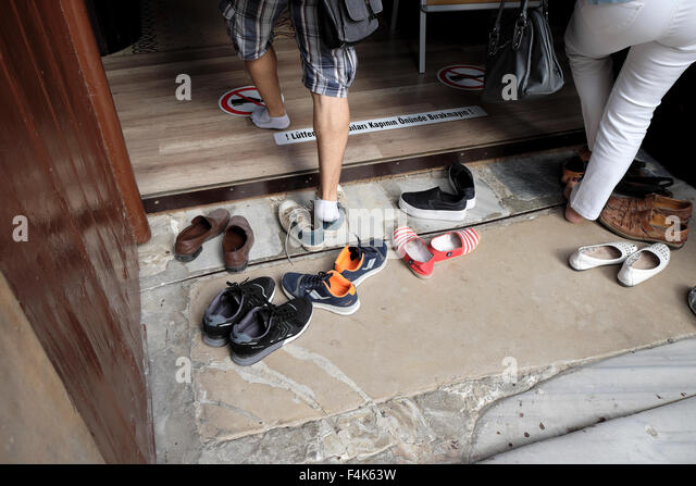 taking off shoes stock photos & taking off shoes stock images - alamy