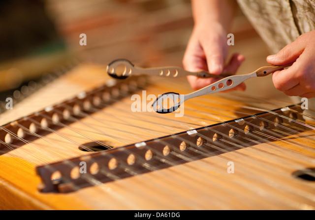 closeup of a person playing the hammer dulcimer stock image