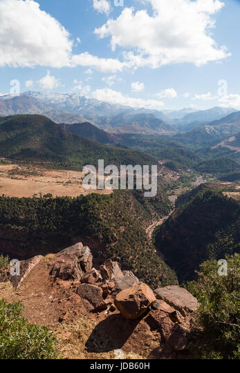 A deep gorge cuts through the arid scenery of the Atlas mountains in Morocco - Stock Image