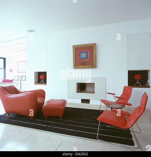 matthew hilton balzac lounge chair and stool in modern white living room with red balzac lounge chair designer
