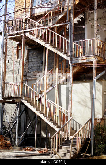 old wooden outdoor spiral stairs in old tbilisi georgia stock image - Outdoor Spiral Staircase