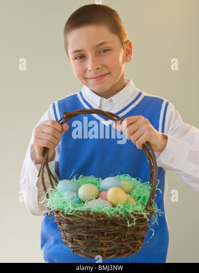 Young boy holding easter basket stock photos young boy holding young boy holding a basket of easter eggs stock image negle Gallery