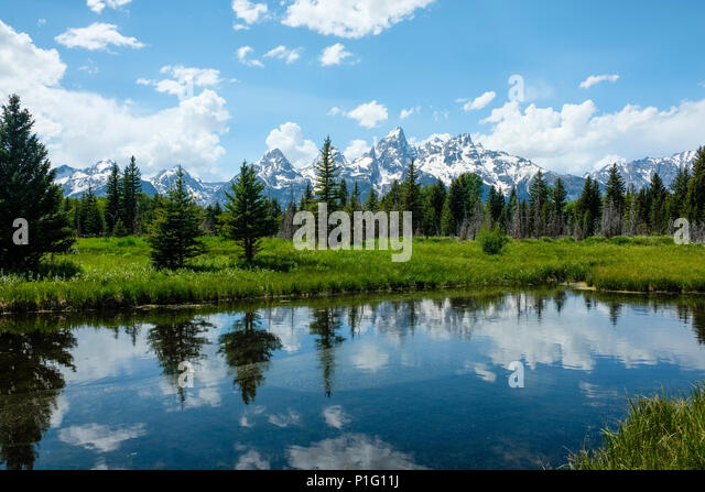 grand-teton-mountains-reflected-in-still