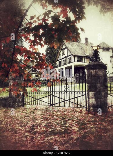 red-autumn-leaves-frame-the-iron-gated-e