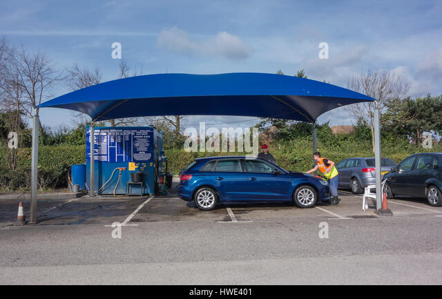 A Car Being cleaned at a Hand Car Wash Unit in a Car Park in Poole & Car Wash Business Stock Photos u0026 Car Wash Business Stock Images ...