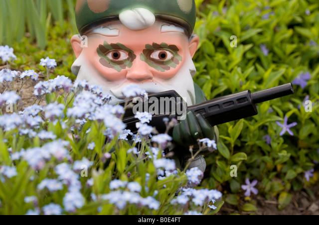 Garden Gnomes With Guns garden gnome garden germany stock photos & garden gnome garden
