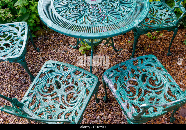 Green metal garden furniture comprising of chairs and round table    Stock  Image. Ornate Garden Furniture Stock Photos   Ornate Garden Furniture