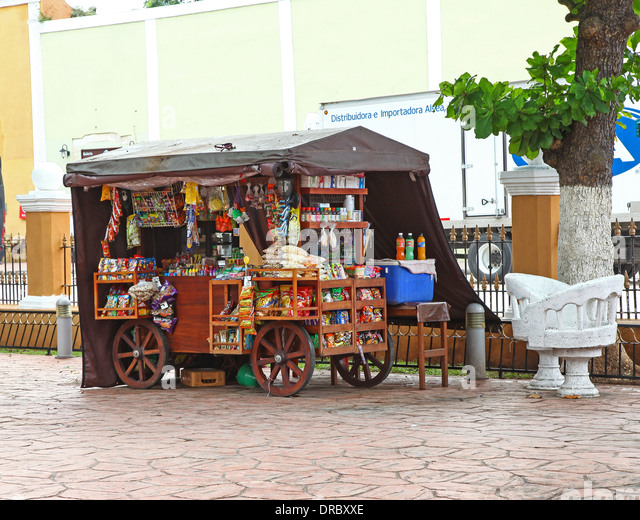 a mobile snack vendor on a wheeled cart or wagon in the park at valladolid mexico
