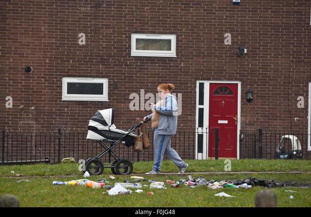 http://l7.alamy.com/zooms/a159a87dbbf24a7eb23bfd74306b5b15/a-mother-pushes-her-pram-through-the-poor-neighbourhoods-in-harpurhey-f0jg48.jpg