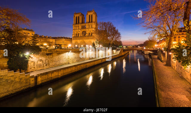 Notre Dame de Paris cathedral on Ile de La Cite at dawn with the Seine River. Daybreak in the 4th Arrondissement, - Stock Image