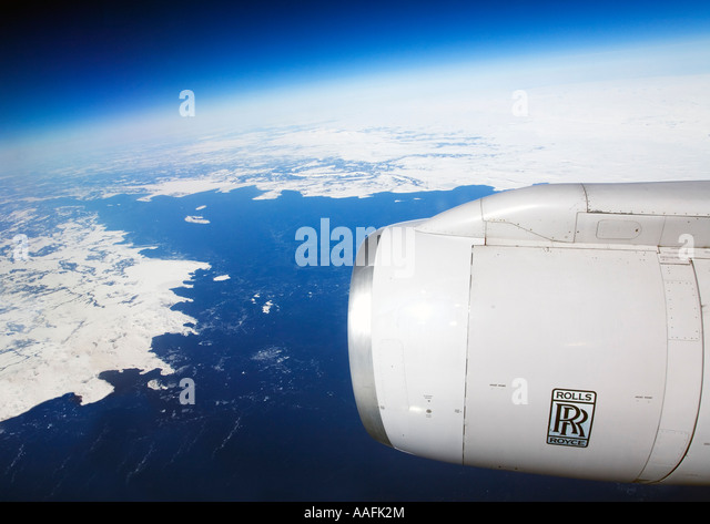 rolls royce aero engine on transatlantic flight jet passenger airplane aeroplane plane with sea snow and