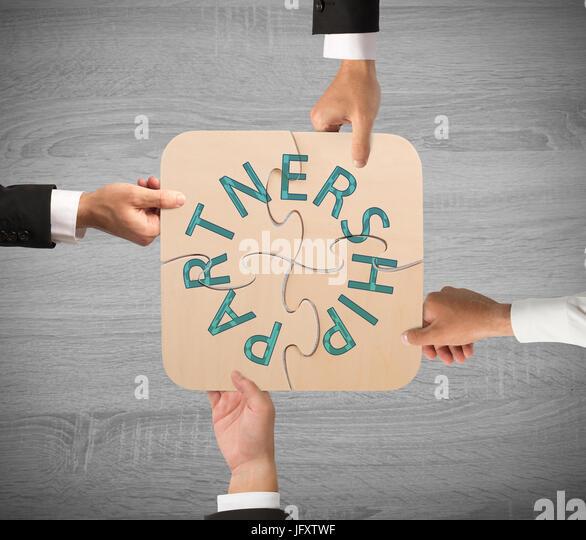 Business partnership puzzle - Stock Image