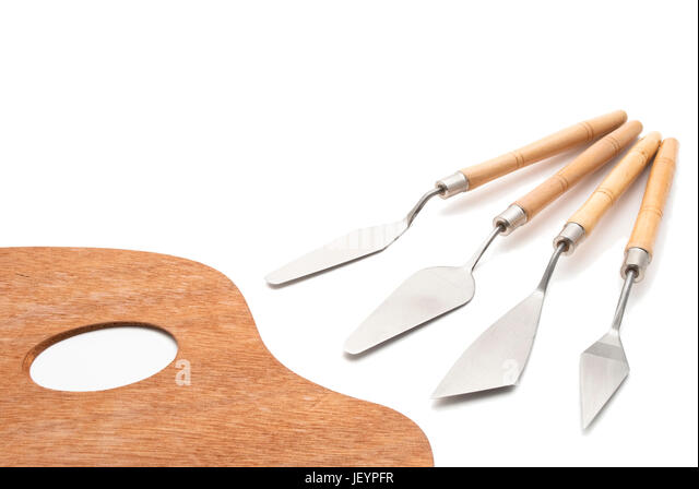 A Traditional Wooden Artists Palette Beside Set Of Knives For Oil Painting Isolated
