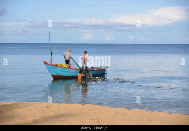 Beach island boat vietnam stock photos beach island boat for Long beach fishing boat